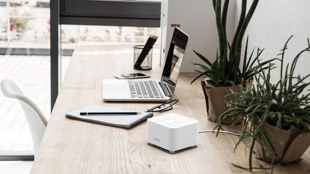 RBK12 Orbi Dual Band Light Wood Desk w_Laptop.jpg