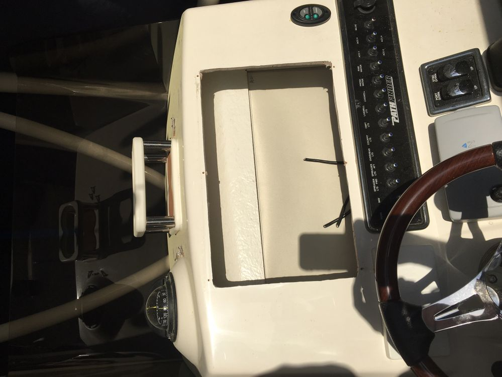 """The hole left by the thieves that stole the 16"""" Garmin chart plotter/fishfinder and ruined all other networked electronics. Over $10,000 loss."""